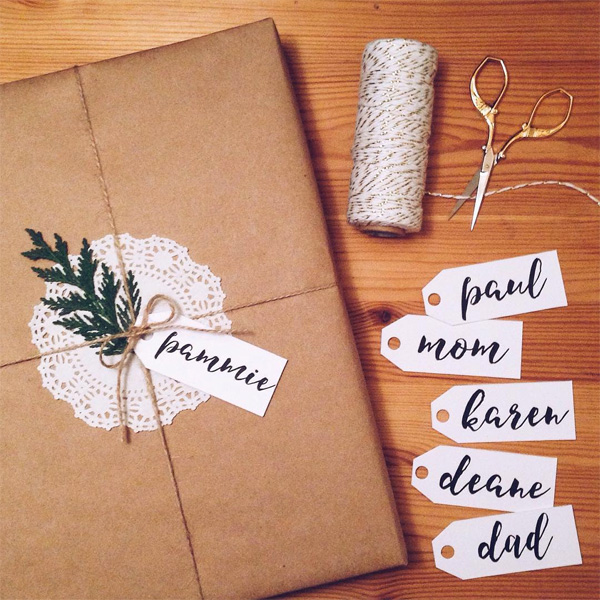 christmas gift wrapping kraft paper baker's twine calligraphy gift tags