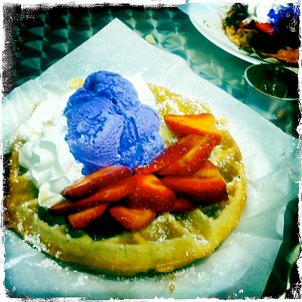 waffle with strawberries and taro ube ice cream and whipped cream